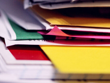stack of papers frustrated about debt